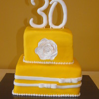 30Th Bday Cake tres leche butter cake w/ caramel buttercream and turtle cake with choc. fudge buttercream. Covered in buttercup colored fondant. Rose and...