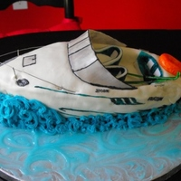 Boat Cake Carved cake to look like my dads boat. Covered in fondant with gumpaste/fondant accents of motor/propeller, skis, steering wheel, seats,...