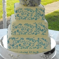 Wedding Cake 3 teirs covered with fondant and scroll work.