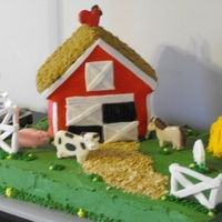 Barn Cake Sheet Cake with buttercream grass, fondant fence, graham cracker path, haystack is cupcake with buttercream. Barn is house pan covered with...