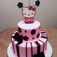 Hello Kitty WASC frosted in buttercream and decorated with fondant accents and a chocolate transfer.