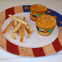 Hamburger And French Fries This is a hamburger cupcake with sugar cookie french fries. I got the idea from bakerella.com. Thank you for the wonder tutorial. Everybody...