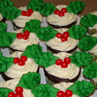 Holly Leaf Cupcakes  Holly leaf cupcakes with sugar cookies as the holly leafs and M&M's as the berries. Got the idea from the Wilton website. Very...