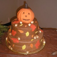 Happy Jack-O-Lantern 14 in round bottom, 10 in round middle, and 6 in ball for the pumpkin. 10 inch tier is vanilla, others are chocolate with chocolate...