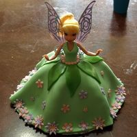Tinkerbell This was a birthday cake for my 9yo daughter. Funfetti cake with Tinkerbell doll. The dress, leaves and flowers are fondant. The...