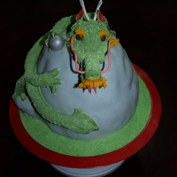 Chinese Dragon The mountain is yellow cake covered in BC and then fondant. The dragon is fondant with gumpaste highlights. The crystal is fondant covered...