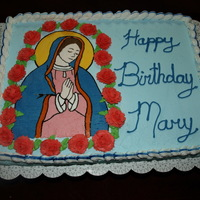 Mary Celebration Cake This was a birthday cake for a celebration on Sept 8th at the Our Lady Help of Christians Center. It's a white cake with covered in BC...