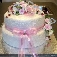 Bridal Shower I made this cake for my friend. I used an acrylic embossing roller and gumpaste flowers.
