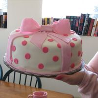 First Time Fondant This cake is covered with white fondant and a pink fondant bow with polka dots. It was so much fun to make! Like playing with playdough!!