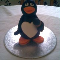 Fondant Pengin I made this for my Daughter'a friend who collects penguin keepsakes. First time making a penguin. Made with fondant and cmc added. A...