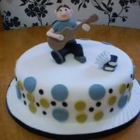 "Son's 19Th Birthday Cake This is a 10"" Madeira, covered in fondant with fondant dots. This is my second figurine really enjoyed doing it. I am always stuck for..."
