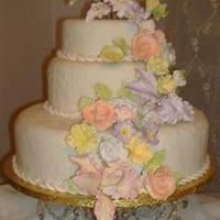 Pastel Wedding Cake   The cake is covered in fondant and sugar flowers