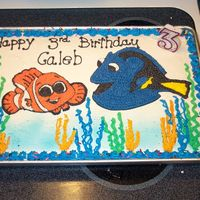 Nemo   I used coloring pages to trace the design on the cake and blue spray to make the water look real