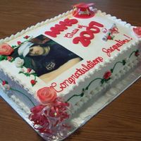 Graduation   banana and chocolate cake decorated with non-dairy whipped frosting, fondant roses and rice paper picture