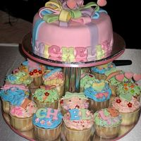 Ribbon Birthday Cake And Assorted Cupcakes