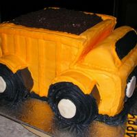 3-D Dump Truck Mostly Buttercream and some Marshmallow fondant.The dirt is crushed Fudgeo cookies.