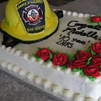 10 Year Anniversary For A Volunteer Fire Fighter   This was a special cake..and my first time attempting a helmet. I used buttercream frosting and marshmallow fondant.