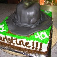 Ride 'em Cowgirl! I know it looks male-ish... but this fondant cowboy/girl hat was done with an image of the Birthday ladies' hat.