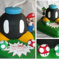 Mario Bros. Bomb! Vanilla cake with buttercream and fondant accents (Action figures are the only non-edibles)