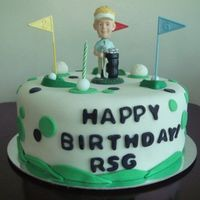 "Mr. Bobble-Head Golfer This is a 10-inch cake with a bobbly headed golfer (made of wax). there are also plastic golf tees (is that correct) and ""grass..."