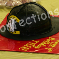 Firefighter Hat  I made this hat for my son's 4th birthday at the fire station. The kids and the fire fighters loved it! It is two 8-inch chocolate...