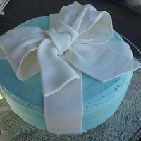 Kathy's Cake WASC with lemon and boysenberry filling and white chocolate bc. My first attempt at a fondant bow.