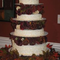 Fall Wedding Cake made for my husband's best friend's wedding. Yellow cake, buttercream icing and silk flowers.