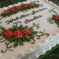 "Pansy Christmas This is a vanilla spice cake with cinnamon buttercream. Royal icing pansies and buttercream leaves. I had intended for this to be ""..."