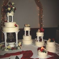 Wedding Cakes This set up is from Wilton ... but I changed the pattern. Scrollwork done with a tip#5. All buttercream with fresh flowers and candles. (If...