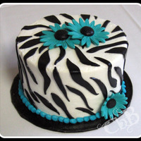 Zebra Birthday Cake BC with Fondant accents. Gumpaste daisies.