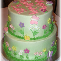 Spring Garden Birthday Buttercream with fondant flowers and bugs.