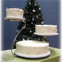 Snowflake Wedding Cake Covered in Fondant with RI and gumpaste accents.