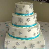 Snowflake Wedding Cake Covered in BC. GP snowflakes with silver sparkle dust, real ribbon. Wedding colors were teal and silver. TFL!