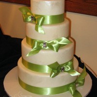 Diamonds & Bows Fondant brushed with pearl dust and satin ribbon. TFL!