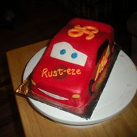Lightning Mcqueen This was a smash cake for a 1st birthday. Lightning was carved out of a loaf pan, iced in buttercream with fondant tires, lightning bolt,...