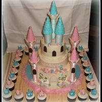 My First Castle Cake  3 tiered castle cake with matching cupcakes.everythings edible except for the towers and the turrets. thank you all for the inspiration!!...