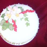 Roses Sugarpaste christmas roses on rolled fondant covered fruit cake