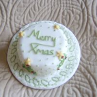Mini Christmas Cake   Outlining skills using a holly leaf and tree pastry cutters as patterns