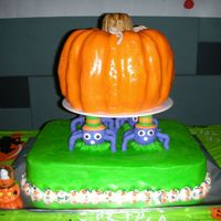 "Spiders Choose A Pumpkin Carved 10"" top cake was covered/sculpted in Shiny, from scratch, Rolled BC (tasted like candy corn!) & was Pumpkin Pound cake w/..."