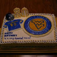 Mountaineer Fan 80Th Birthday Frosting & borders with almond flavored buttercream frosting. FBCT for emblem & football jersey using same frosting. This was a...