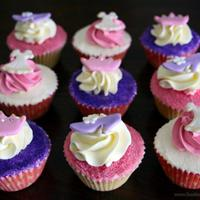 Princess Cupcakes Princess Cupcakes - Vanilla cupcakes covered with a thin layer of buttercream icing, dipped into sugar crystals and then topped with an...