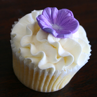 Purple Flower Wedding Cupcakes A cupcake with buttercream icing frilly swirl and topped with a vivid purple embossed flower! Thanks for looking...