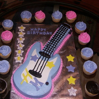 Hanna Montana Guitar Cake  Made this for my grand daughters 6th birthday - she loved it! I got the guitar template from Betty Crocker's website using a 9 x 13...