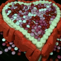 Happy Valentine's Day!  Made this for my honey .... red velvet with cream cheese frosting (both recipes from this site). Wish the M&M's color matched the...