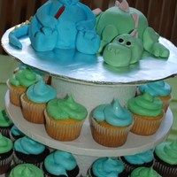 Dinosaur Party   cupcake size cakes stacked and carved... covered in fondant. heads, legs and tails in fondant :D