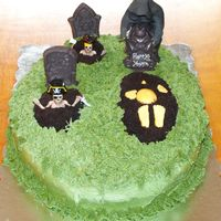 Loss Of Harry's Youth - Graveyard Over The Hill Cake Graveyard cake - Grim Reaper putting in the tombstone on the last fresh grave...Buttercream Icing over a standard Yellow Cake with...