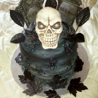 Skull/graveyard Cake Lat minute cake I whipped up for a same day event. Pumpkin Cake with Chocolate cake - Rum Buttercream filling. Cake iced in buttercream.