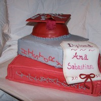 High School Graduation Cake The bottom is strawberry cake the rest are yellow cake. The bottom two are BC and the cap is fondant. Hand painted the fondant diploma....