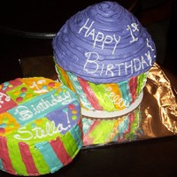 1St Birthday Giant Cupcake Cake This is a chocolate cake with BC icing. I used the silicone cupcake pan from the infomercial, but I got it at a local toy store. Made to...