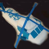 Black Hawke Helicopter Customer wanted white cake with blue trimmings. TFL
